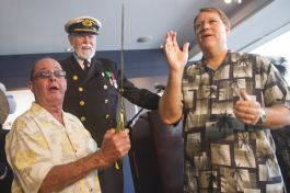 Bill Edwards, Lowell Lytle aka Capt. John Smith and Mayor Baker cheer after cutting the ribbon for t