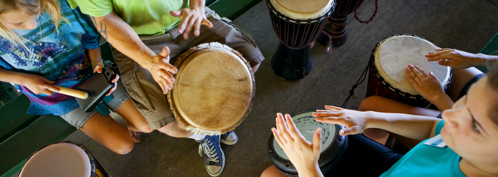 Steve Turner of Giving Tree Music leads a drum circle. - Julie Branaman