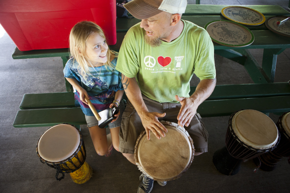 Steve Turner and his daughter Sequoia play a drum circle.