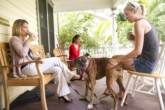 (L-R) Adrianna Williams, Heather Jordan, Meredith McKay and Foxy the dog enjoy the porch at Jet City