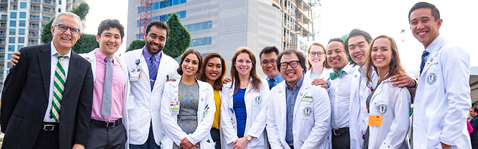 Dr. Panos Vasiloudes poses with medical students at the November topping off-ceremony for the new USF Health Morsani College of Medicine and Heart Institute. <span class='image-credits'>USF, USF Health Morsani College of Medicine and Heart Institute</span>