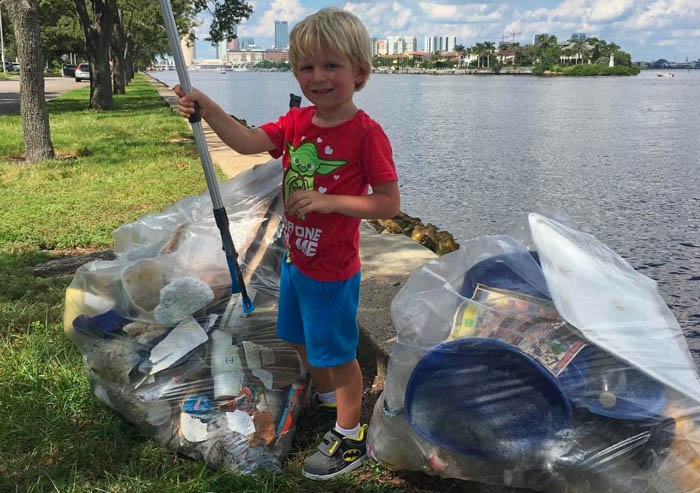 Cleanup is a family affair. Here, the youngest Mueller, Luke, does his part.