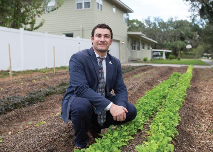 Chris Castro, Dir., of Sustainability & Resilience for the City of Orlando at an urban front-yard farm, part of the Fleet Farming program.