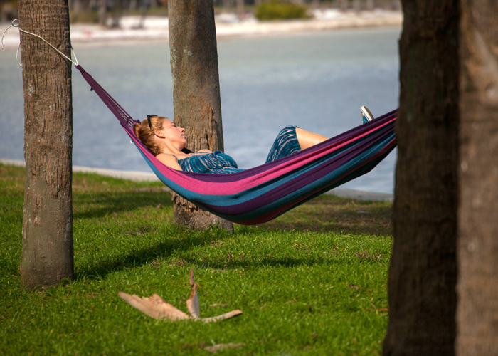 A woman relaxes on a hammock along St. Pete's waterfront.