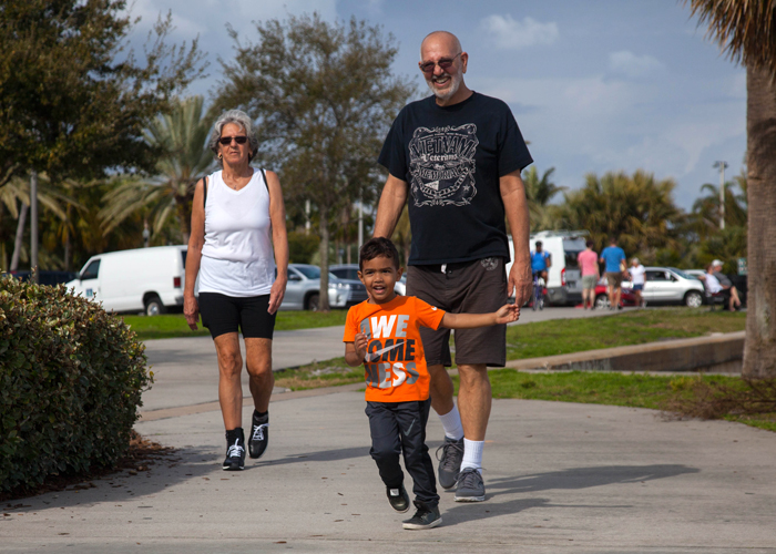 A family passes the North Shore Aquatic Complex in St. Pete.