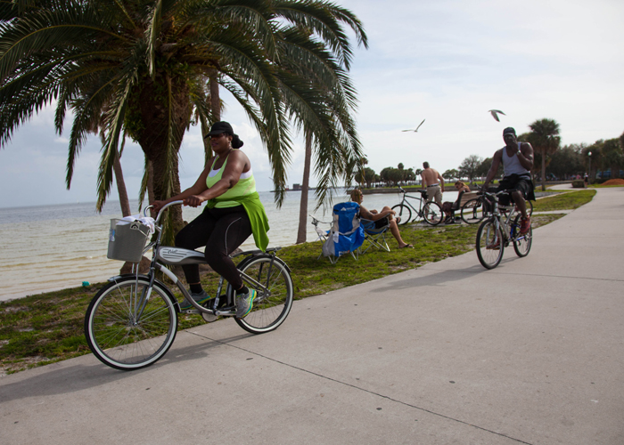 Cyclists along the waterfront in downtown St. Pete.