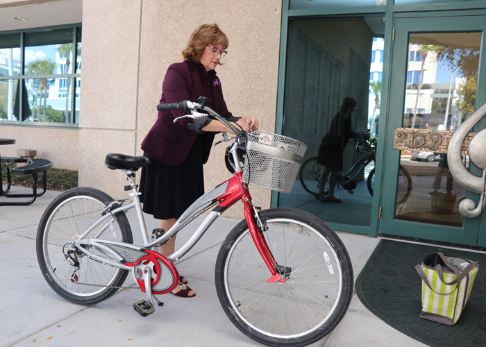 Christine Acosta, founder of Pedal Power Promoters, arrives to lead a bike safety class at the Straz Center in downtown Tampa.
