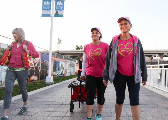 (L-R) Gia Metcalf, left, Maribell Figueroa, a breast cancer survivor, and Sylvia Campbell, a breast cancer surgeon, help feed Tampa's homeless in the early morning hours.
