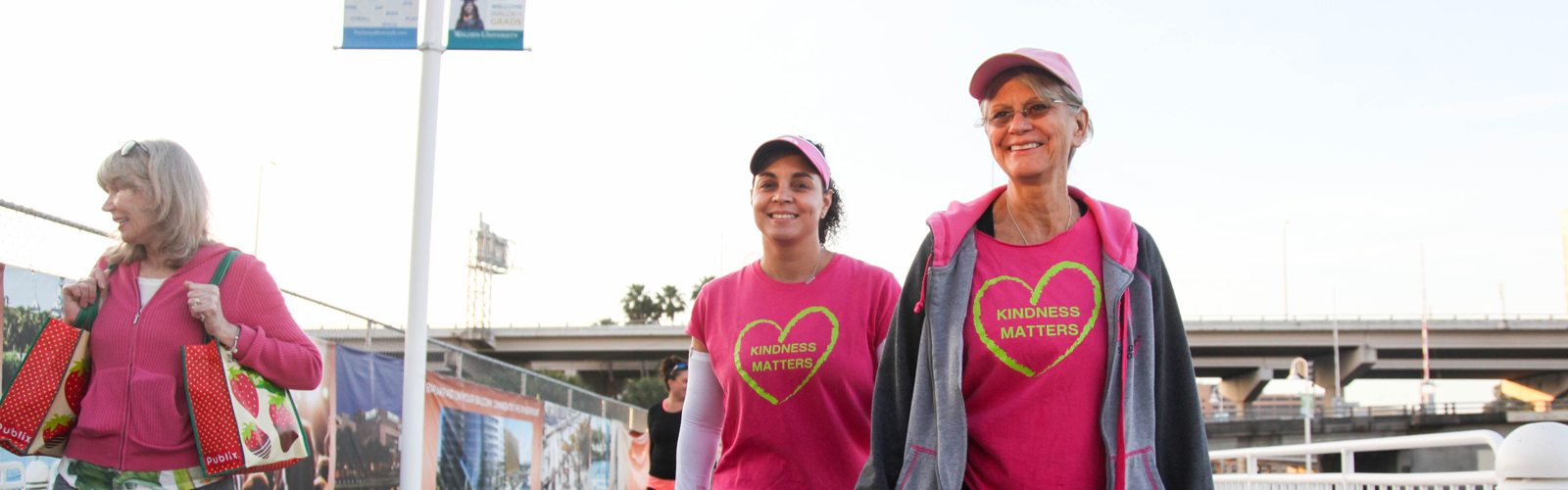 (L-R) Gia Metcalf, Maribell Figueroa, a breast cancer survivor, and Sylvia Campbell, a breast cancer surgeon, help feed Tampa's homeless.  <span class='image-credits'>Amber Sigman</span>