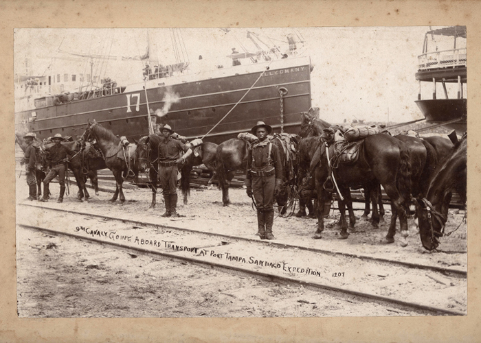 The ninth calvary boarding transport at Port Tampa during the Spanish American War.
