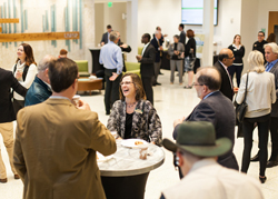 Attendees at the first Sunny Side Up forum wait in the lobby of Lynn Pippenger Hall at the USFSP College of Business.