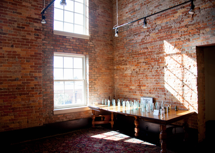 Antique bottles sit inside the historical Florida Brewery that is now used as space for lawyers who honor the building's history.