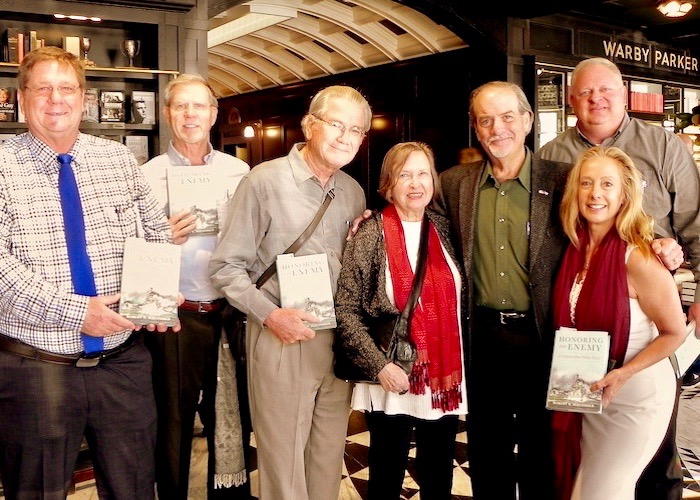 Cafe con Tampa patrons pose with Author Robert Macomber at Oxford Exchange.