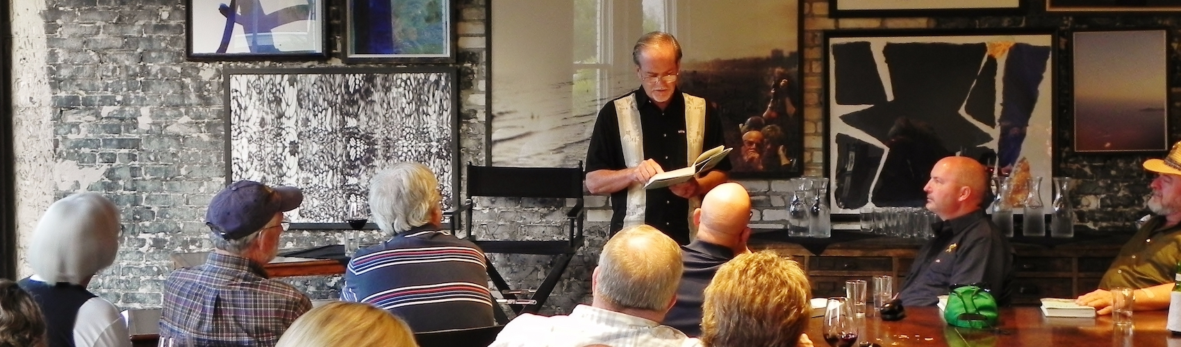 Author Robert Macomber reads aloud from Honoring the Enemy at Oxford Exchange book signing. <span class=&apos;image-credits&apos;>Nancy Glickman</span>
