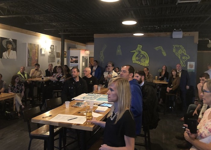 Residents and business owners discuss forming a business association at Urbanism on Tap.