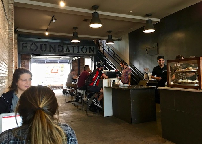 Patrons carve out workspace inside Foundation Coffee Co. on North Franklin in Tampa Heights.