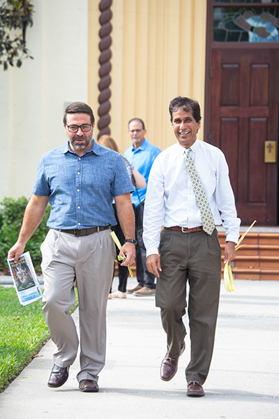 Elvin Martinez, left, and Jacob Kallupura after a Palm Sunday service in West Tampa.