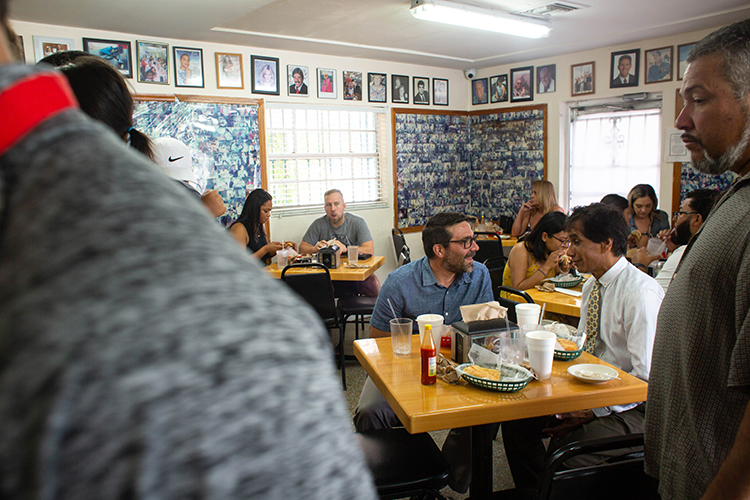 Elvin Martinez, left, and Jacob Kallupura have breakfast at the West Tampa Sandwich Shop.