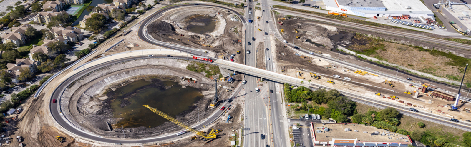 An aerial view of the ongoing construction of the Selmon Extension. <span class='image-credits'>Aerial Innovations</span>