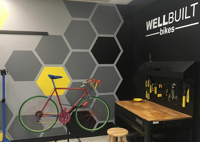 WellBuilt Bikes has created a replica of their shop at Pepin Academy where students can learn how to work on and repair bikes.
