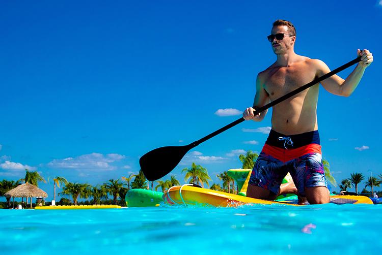 A model demonstrates what it could be like to paddleboard at Crystal Lagoon.