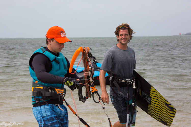 Anthony Franchi, right, with Kiteboarding St. Petersburg walks past a fellow rider.