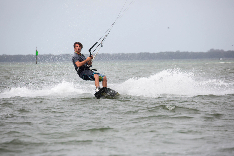 Anthony Franchi, owner and instructor, with Kiteboarding St. Petersburg surfs near the Skyway.