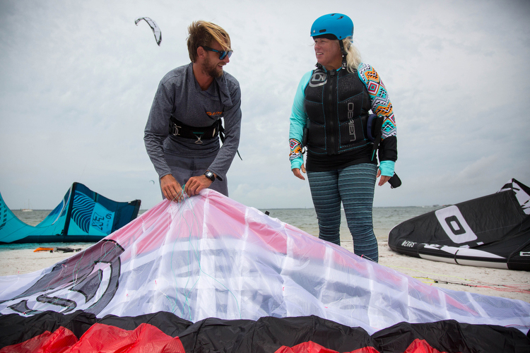 Dave Tichman and Barb Draves prepare to head out in 26 mph winds for kiteboarding lessons.