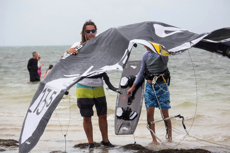 Kevin Castillo, a lead instructor with Elite Watersports, helps out fellow kiteboarders.