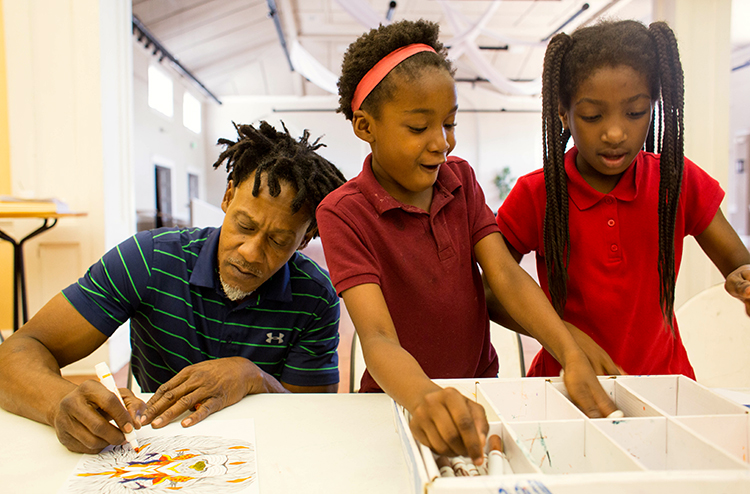 Roddrick Davenport works on therapeutic art with kids at the Tampa Heights Community Center.