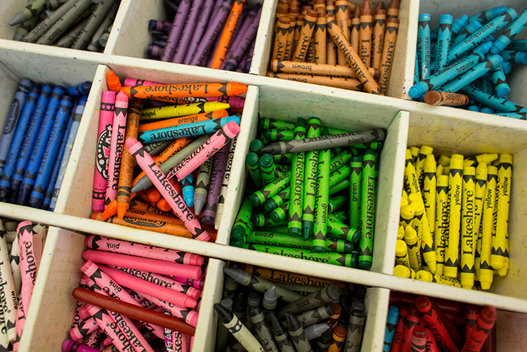 Crayons are used in a stress-relief art session for after-school kids.