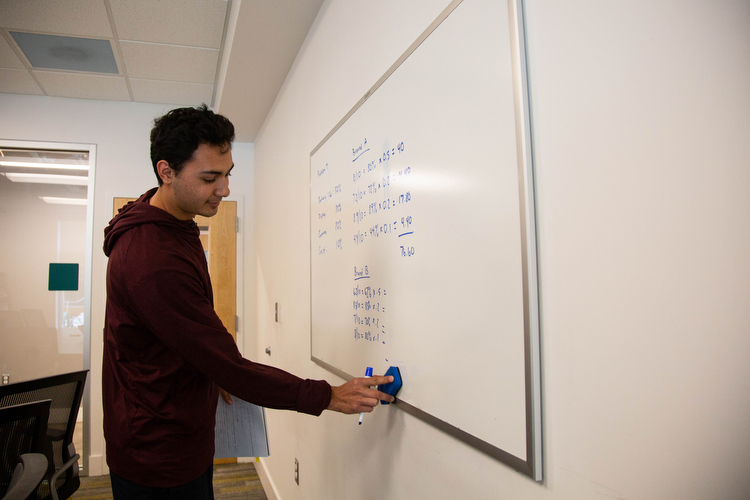 Isaac Mendez studies for a statistics class inside Beacon Hall.