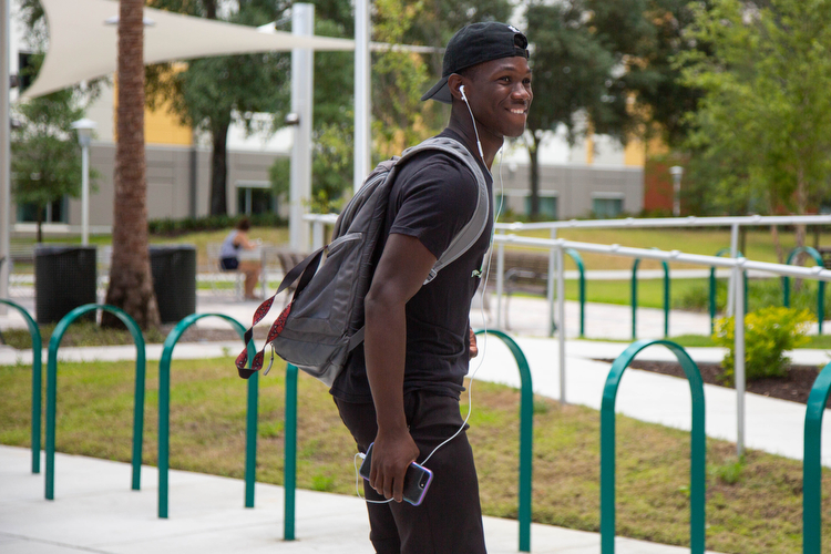 A student skates past while heading to class at USF.
