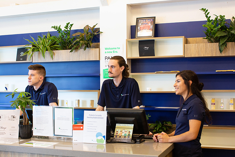 Graham Johnson, Natalia Lopez, and Andrew Squires assist customers at Liberty Health Sciences medical marijuana dispensary in St. Pete.