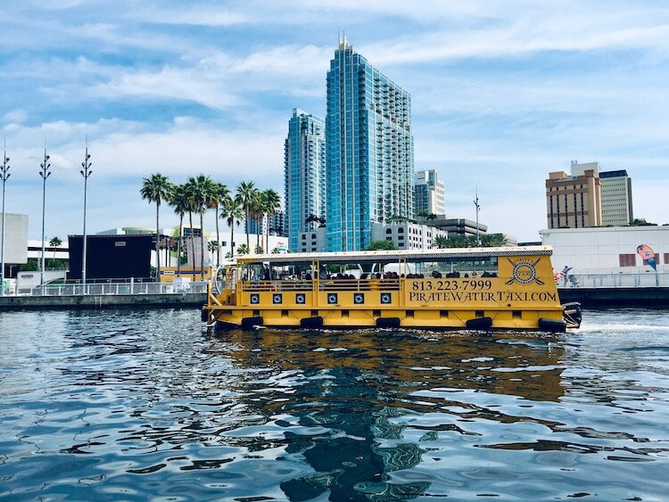 A water taxi traverses the Hillsborough River in downtown Tampa.