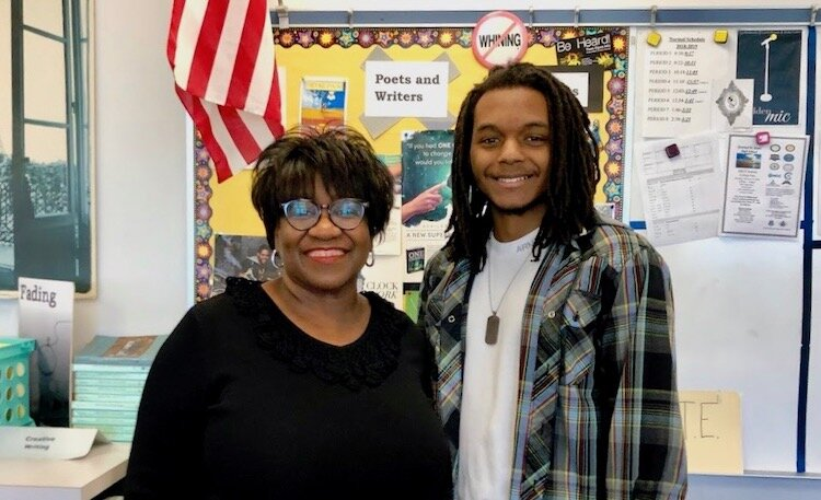 Poetry Out Loud winner Zhaedyn Hodge Sigars and his mentor, Blake High School's Casey Curry of Tampa.