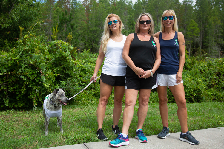 "Yvette Boué, her dog Dixie, Lisa Acierno, and Deborah Ingalls days before the 16 mile ""Out of the Darkness Overnight Walk""."