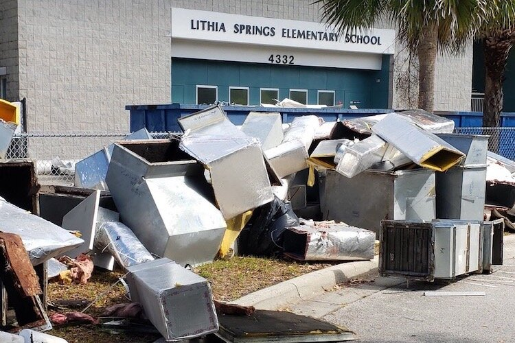 Construction debris piles up outside Lithia Springs Elementary in Valrico in East Hillsborough County.