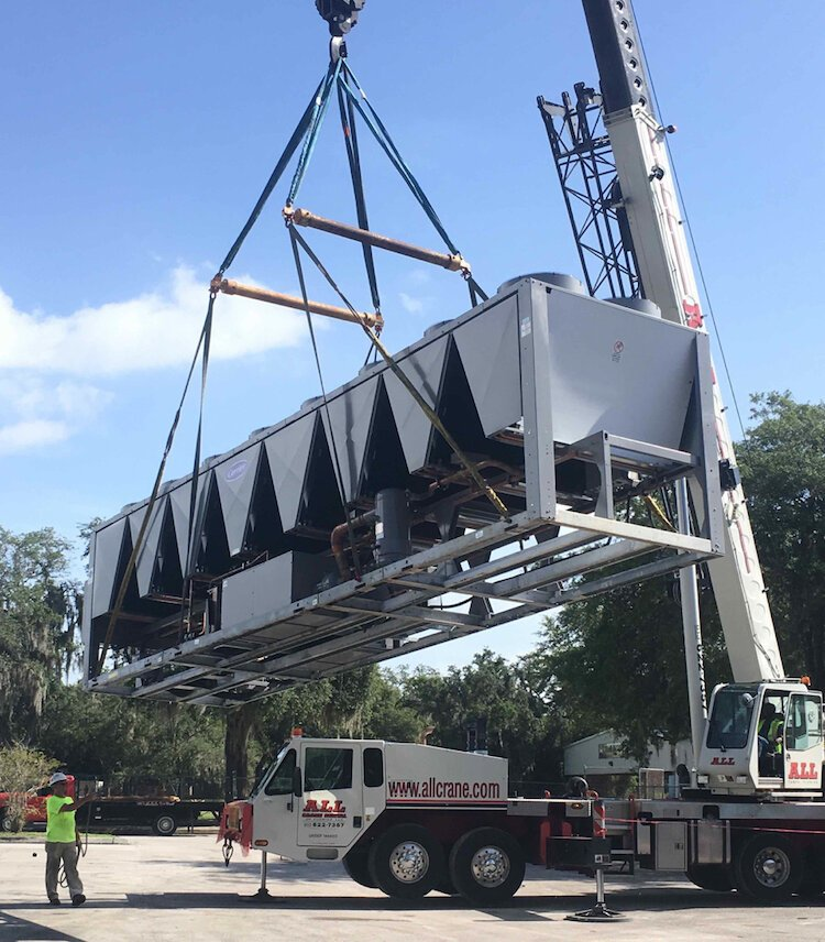 A crane lifts a new air handler at Walden Lake Elementary in Plant City.