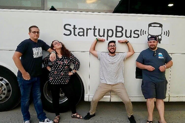 Nick Price, Lead Conductor of StartupBus Florida 2019 (in tan pants), prepares to board the bus with team members.