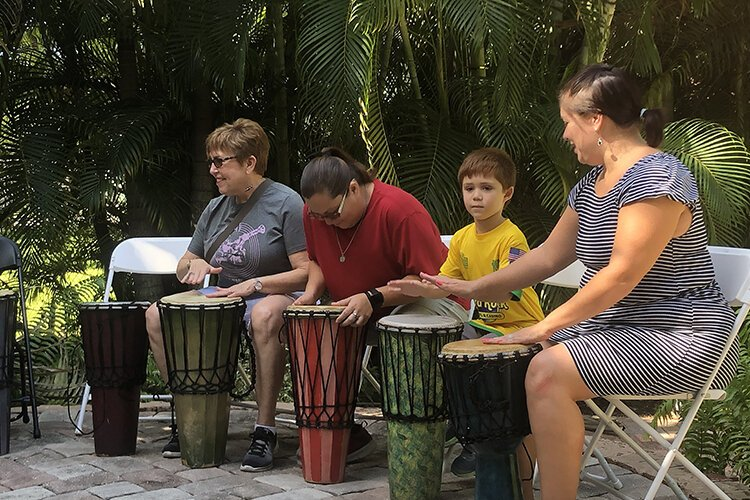 Guests participate in music performance at the Woodson Museum in St. Pete.