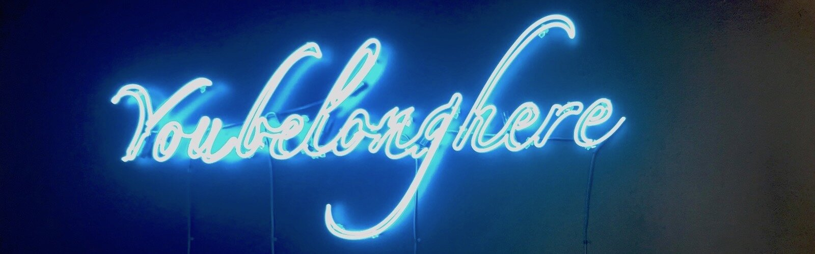 You Belong Here neon light artwork on display at Scarfone/Hartley Gallery in Tampa.