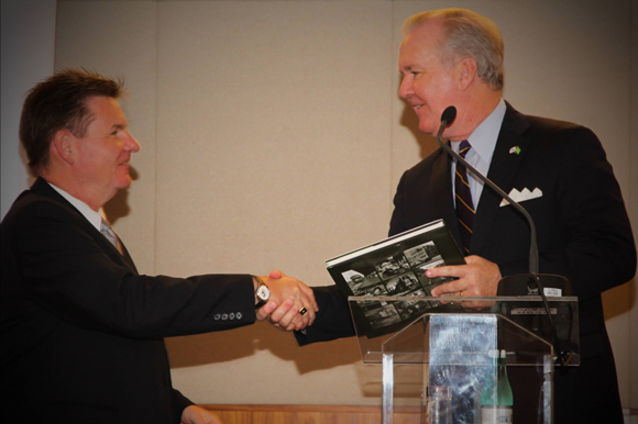 Mayor Bob Buckhorn gives a gift to U.S. Consul General Dennis Hankins