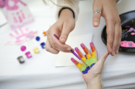 Abby Paterson paints St Joseph's patient Reagan Kelly's hand during an art therapy session at the ho
