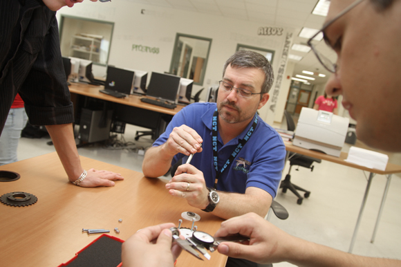 Nature Coast Robo-Sharks teacher Ed Fry works with students. - Julie Busch