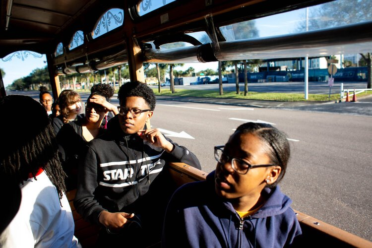 Students pass through the lost neighborhood of Gas Plant where 285 buildings and 500 houses that were once owned by African Americans in St. Pete, but were forced out to make way for the Tropicana stadium.