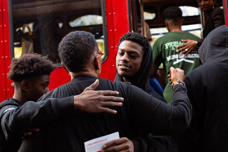 Two young men on the south side of St. Pete spontaneously join the tour, to learn about African American history, hugging and thanking Gwendolyn Reese as they depart.
