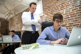 Matt Dreger works with VIP Software intern Matt Aberham. - Julie Branaman