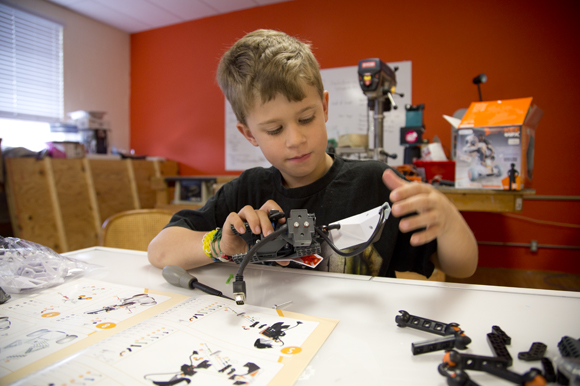 Aaron Ryley, 8, builds a robot at Tampa Hackerspace during Kid's Open Make Day. - Julie Branaman