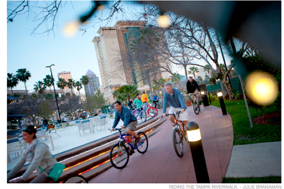 Cyclists on the Riverwalk in Tampa.